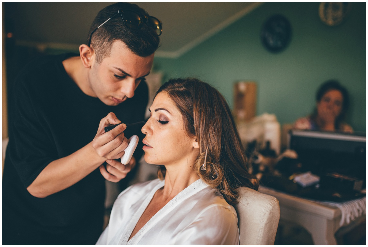 Beautiful destination wedding bride getting her makeup done by her Italian MUA on her wedding morning.