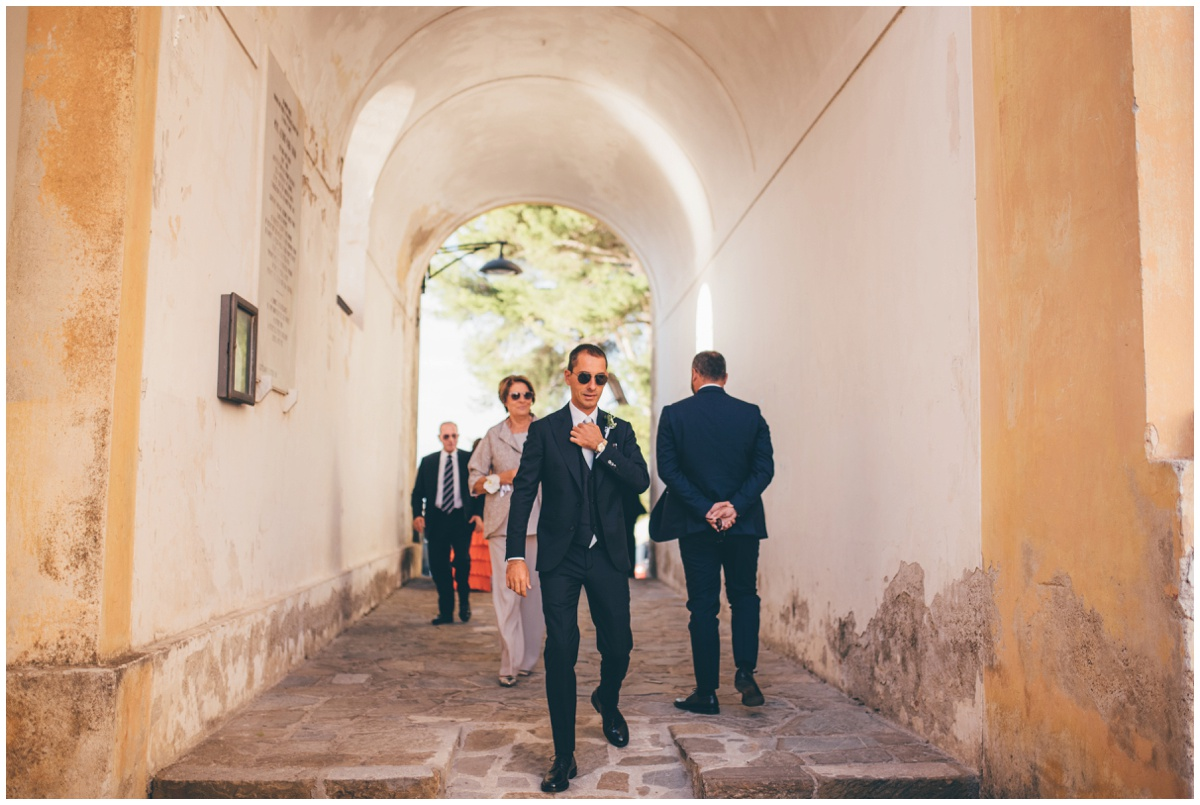 The groom and his groomsmen walk towards his wedding venue in Santa Maria di Castellabate.