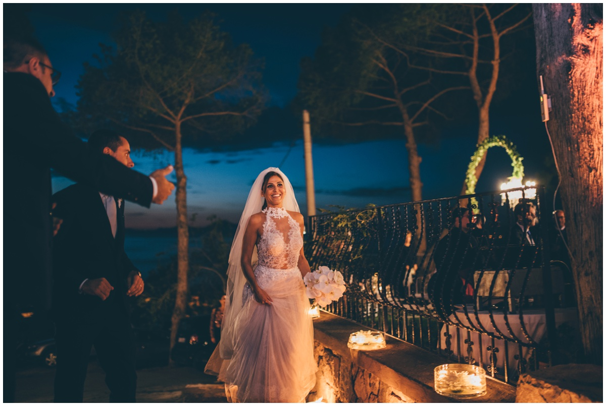 Beautiful bride arrives at her wedding reception in Italy.