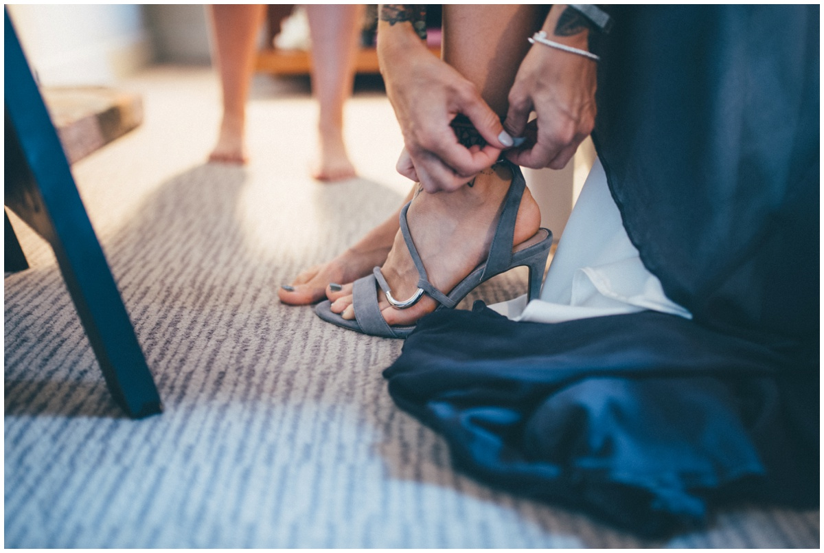 The bride fastens up her Carvela by Kurt Geiger wedding shoes.