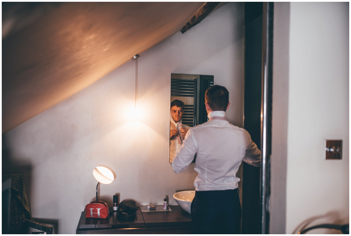 Groomsman gets ready at Oddfellows in Chester.