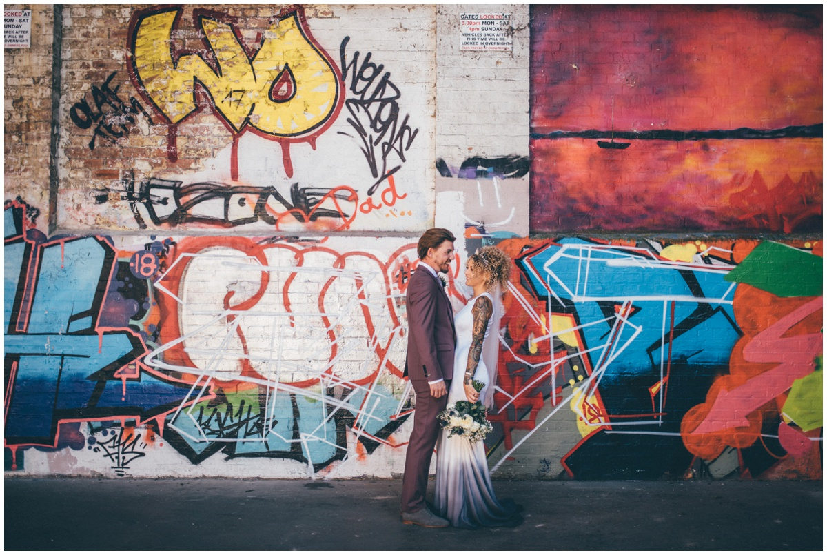 Stunning bride and groom in graffiti filled car park in Chester.