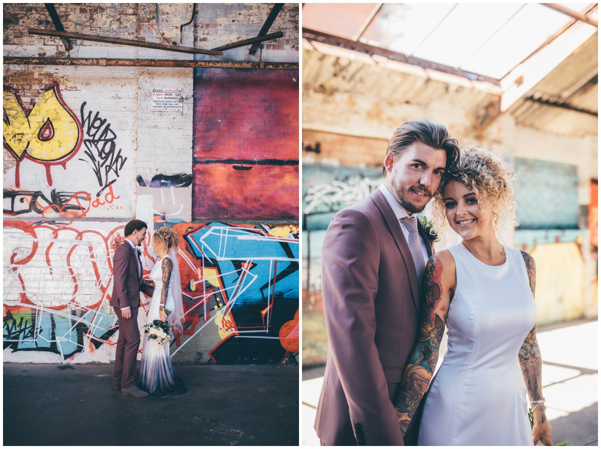Bride and groom pose for wedding portraits in graffiti car park in Chester.