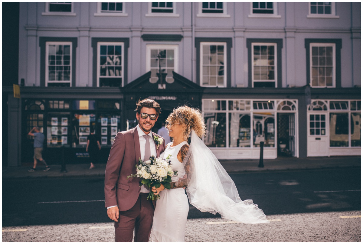Bride and groom stand outside their city centre wedding venue in Chester.