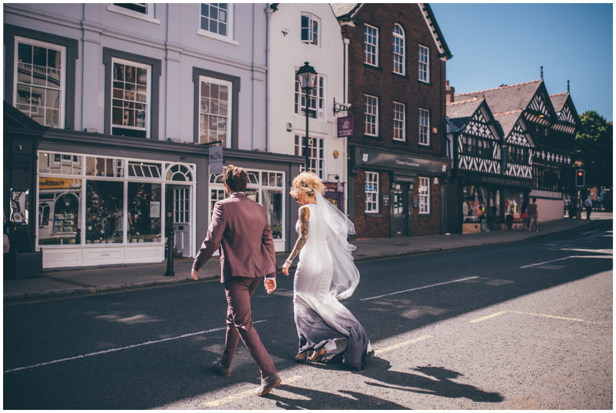 Bride and groom cross the road in Chester towards Oddfellows.