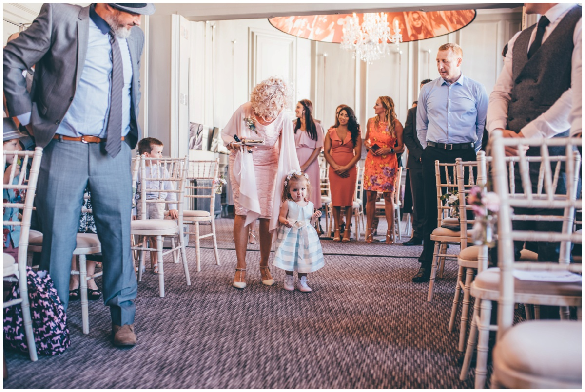 Flowergirl walks down the aisle with mother of the bride at Oddfellows in Chester.