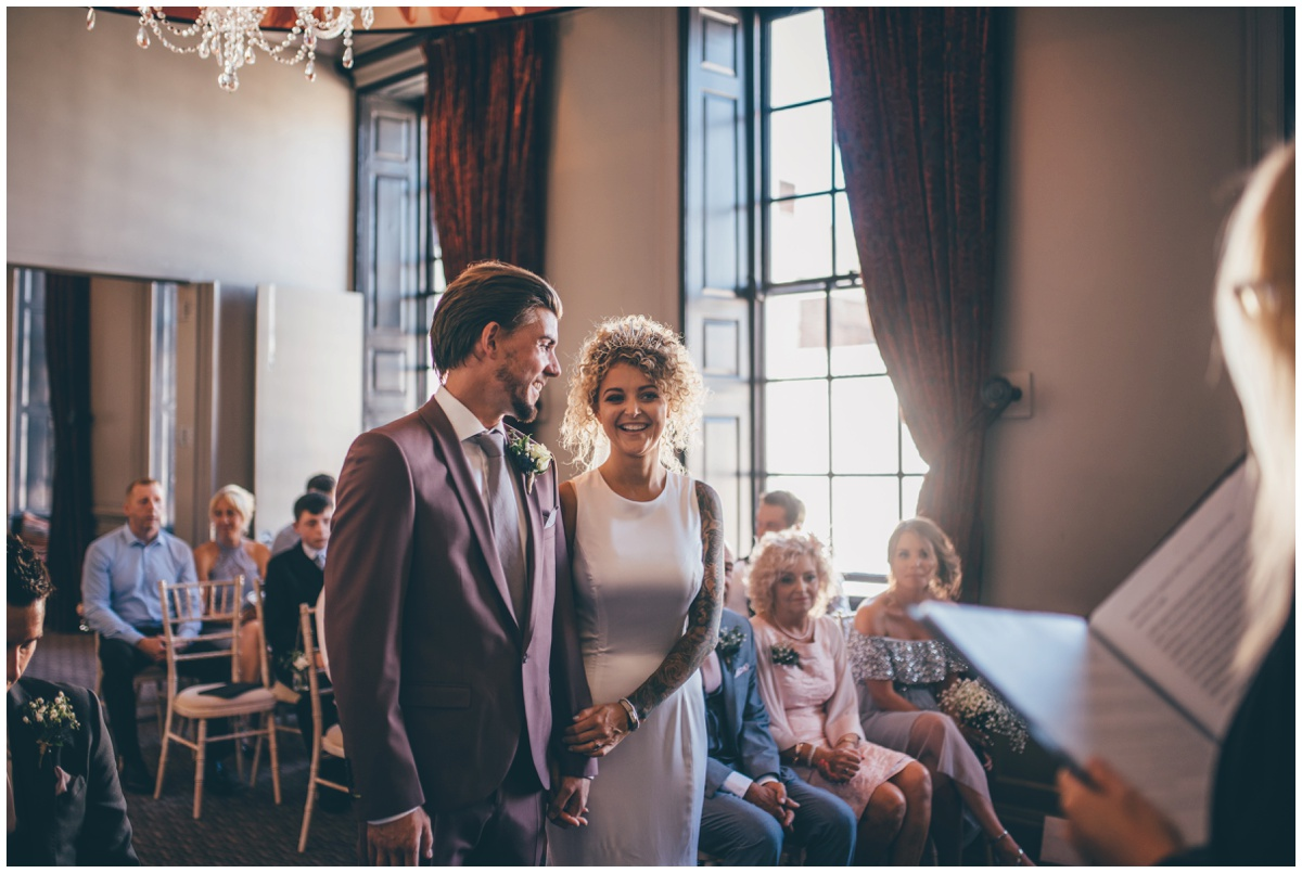 Groom looks at his beautiful bride during their wedding at Oddfellows in Chester.
