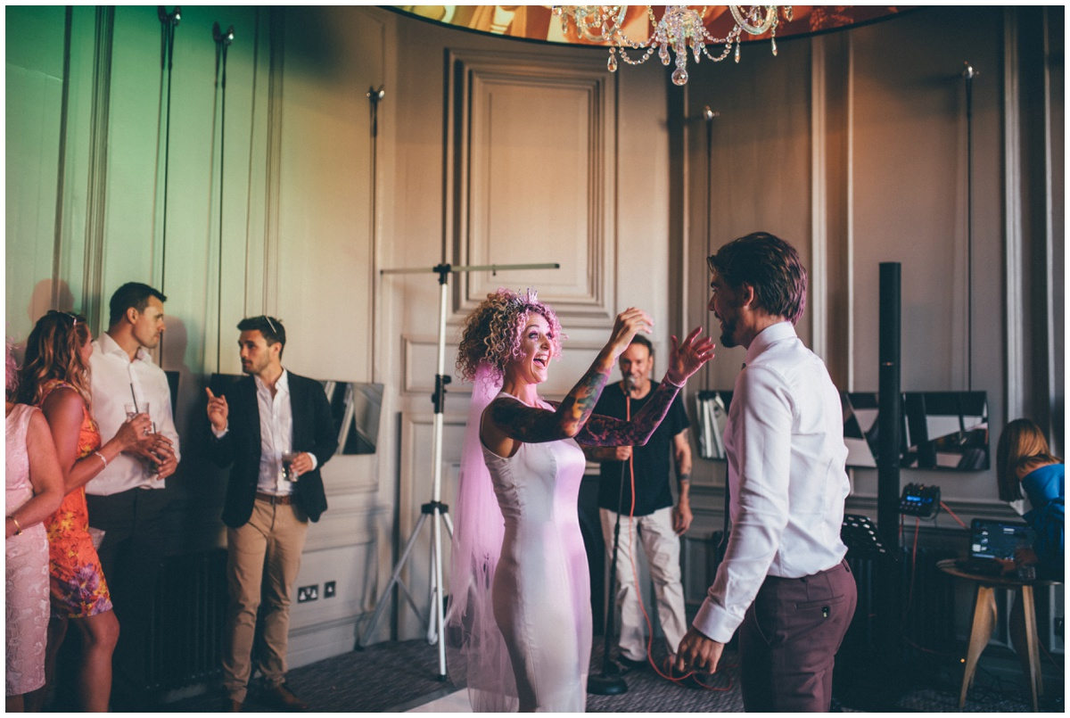 Tattooed bride and groom in pink suit start their First Dance in Chester.