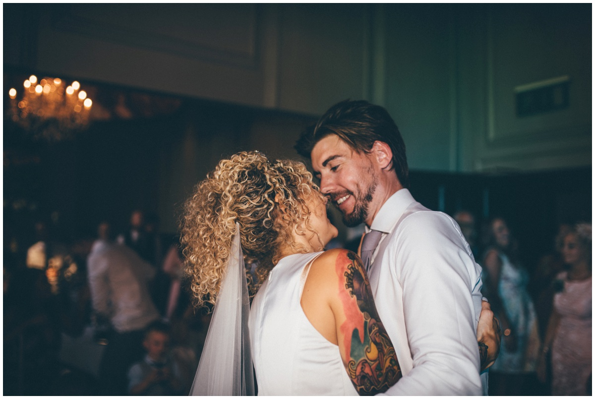 Tattooed bride and groom in pink suit do their First Dance in Oddfellows, Chester.