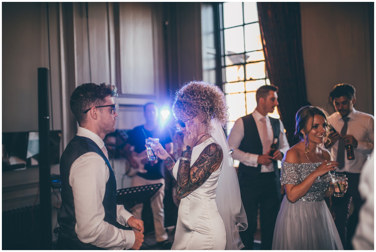 Wedding guests dancing with tattooed bride at Oddfellows city centre wedding.