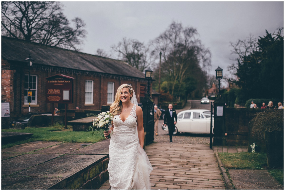 Beautiful bride arrives at the church on her wedding morning.