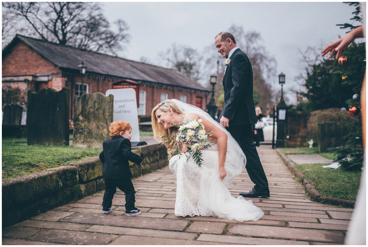 Bride greets her son when she arrives at the church in Cheshire.