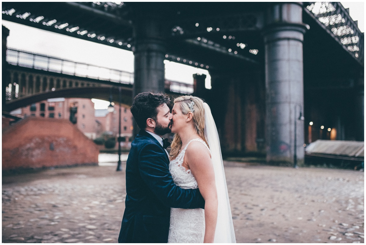 New Years Eve bride and groom pose for their wedding photographs in Castlefield, Manchester.