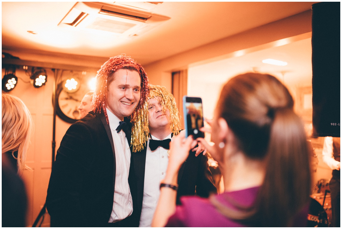 Wedding guests celebrate at New Years Eve wedding at Great John Street Hotel in Manchester.