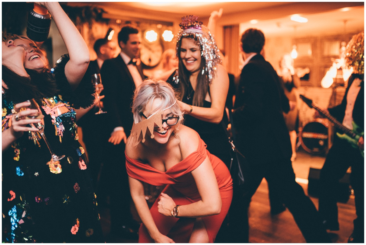 Wedding guests dance at New Years Eve wedding at Great John Street Hotel in Manchester.