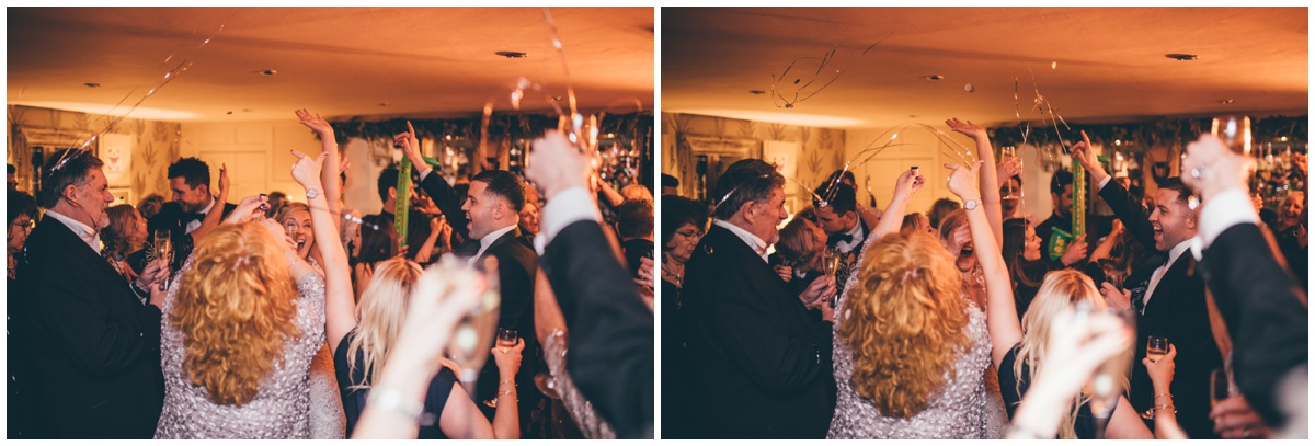 Wedding guests celebrate the New Year at New Years Eve wedding at Great John Street Hotel in Manchester.