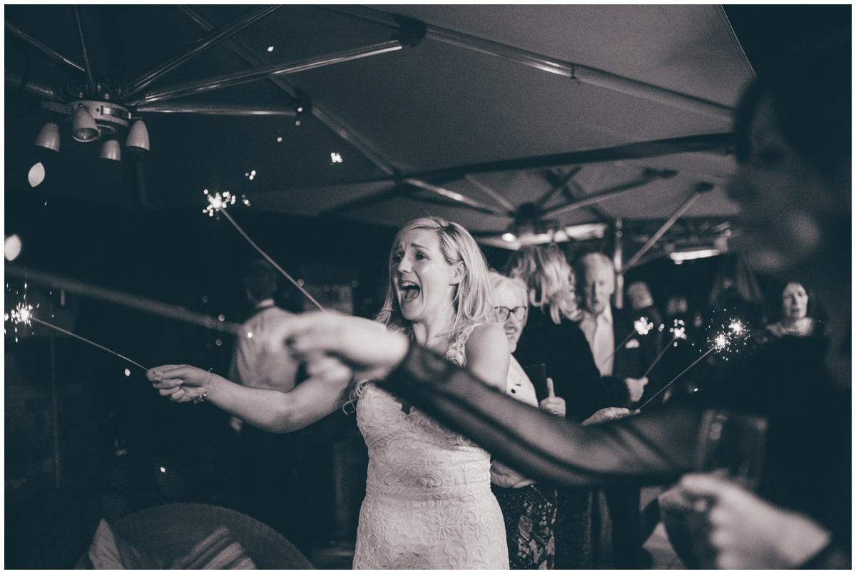 Wedding guests celebrate the New Years with sparklers at New Years Eve wedding at Great John Street Hotel in Manchester.