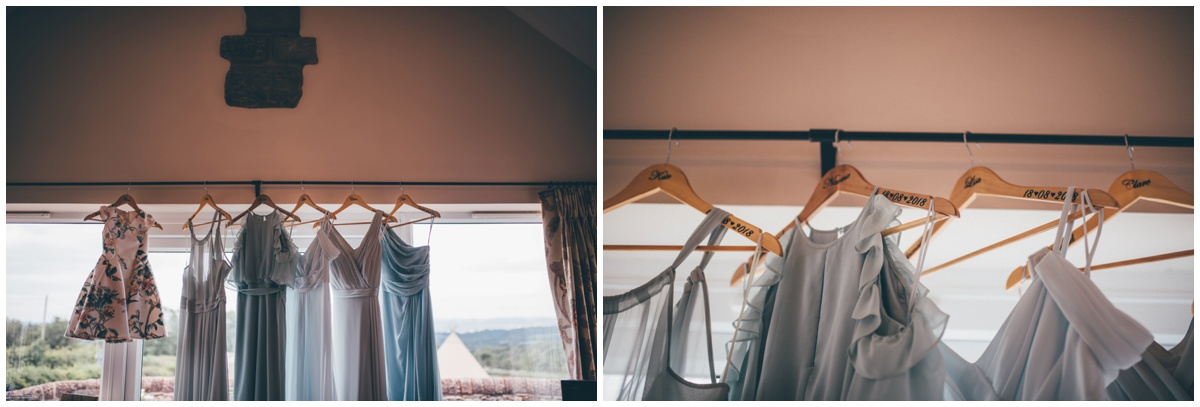 Blue bridesmaid dresses hung up in preparation for the Big Day.