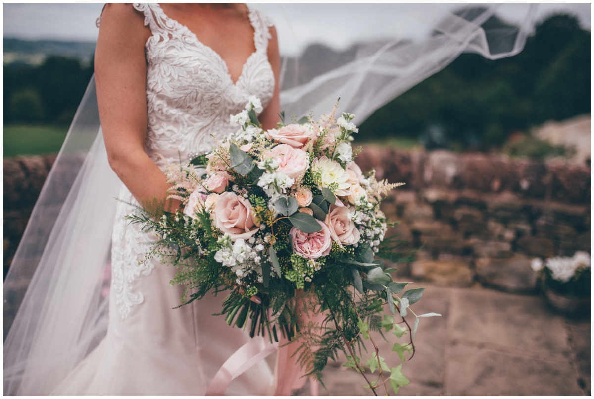 The Staffordshire bride-to-be holds her stunning pastel coloured wedding bouquet.
