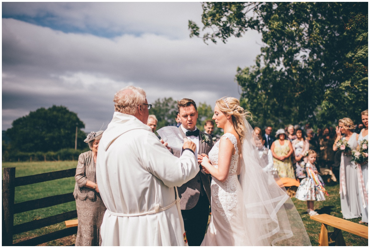 Wedding blessing in a sunny field in summer.