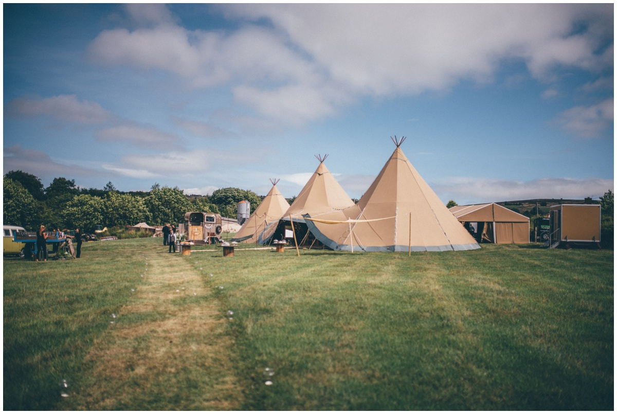 Wedding Tipis in a family field on a beautiful summers day, by Cheshire wedding photographer.