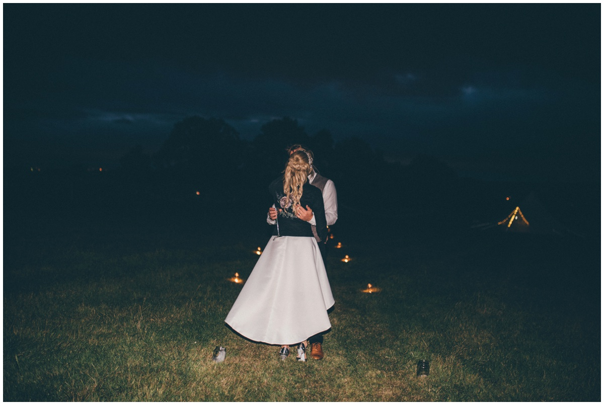 Bride and groom enjoy their evening reception at their tipi wedding in Staffordshire.