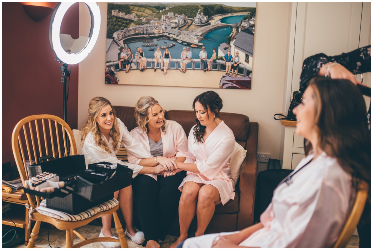 Bride jokes with her bridesmaids on the wedding morning in Cheshire.