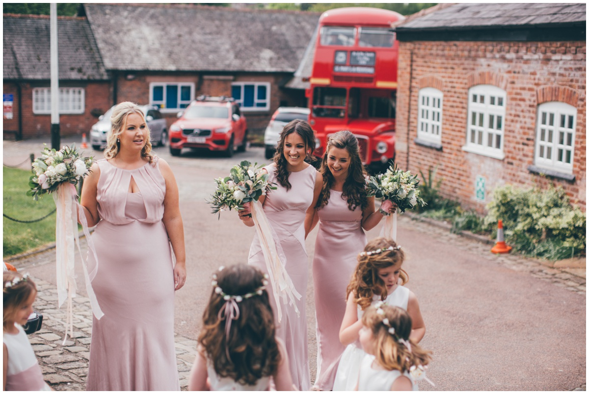 Bridesmaids waiting excitedly at St Mary's church for the bride to arrive.