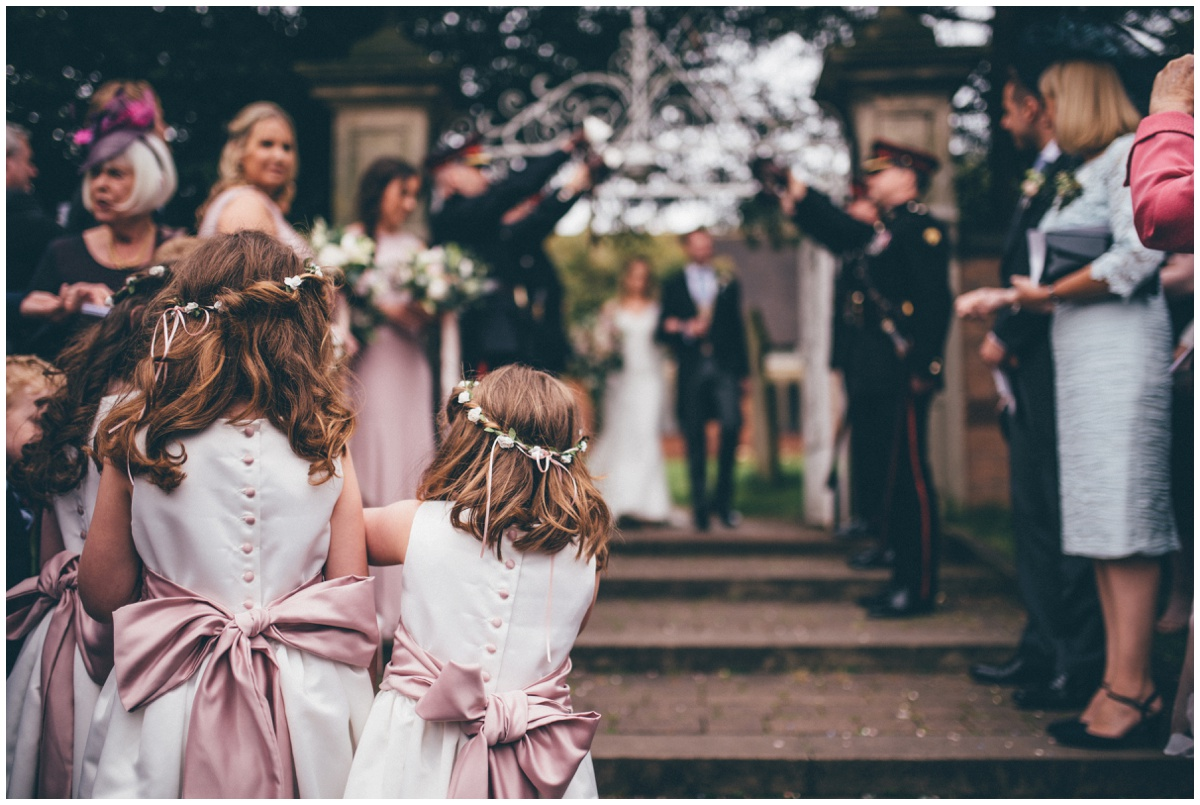 Flowergirls wait to throw confetti at St Mary's Church in Cheshire.