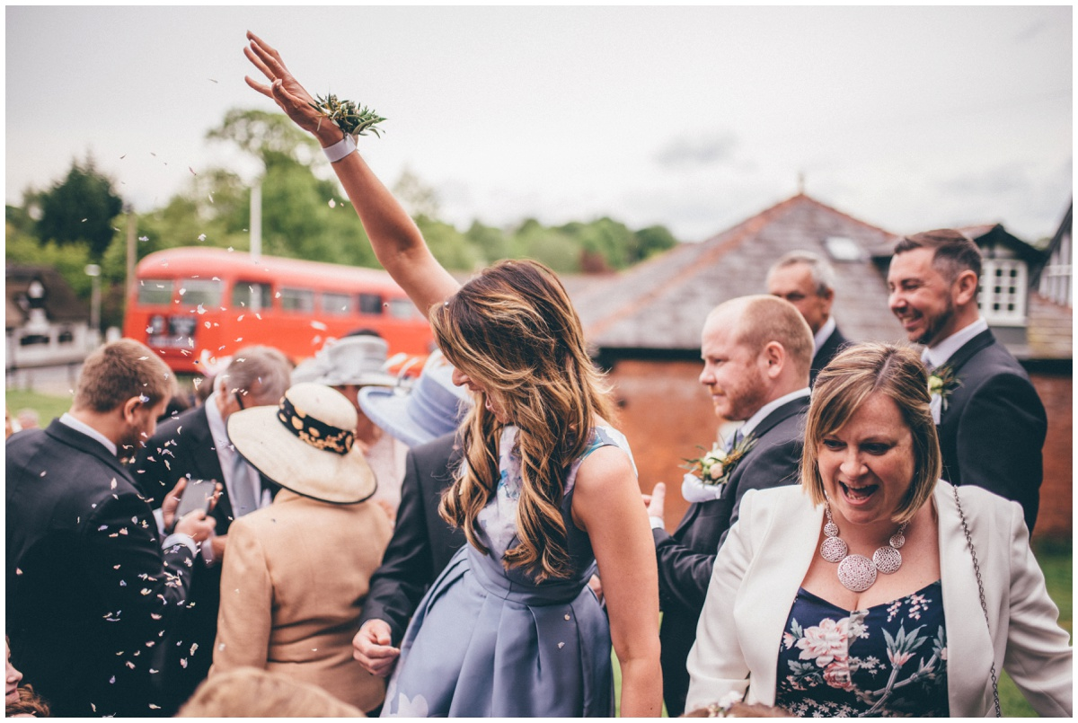 Wedding guest throws confetti at the bride in Cheshire.