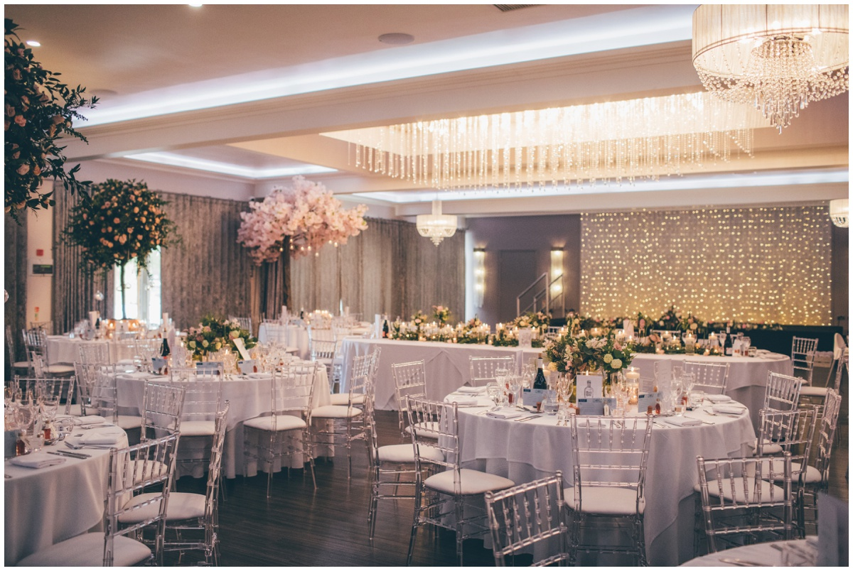 Red floral decorated the wedding venue, Merrydale Manor in pastel flowers and candles.