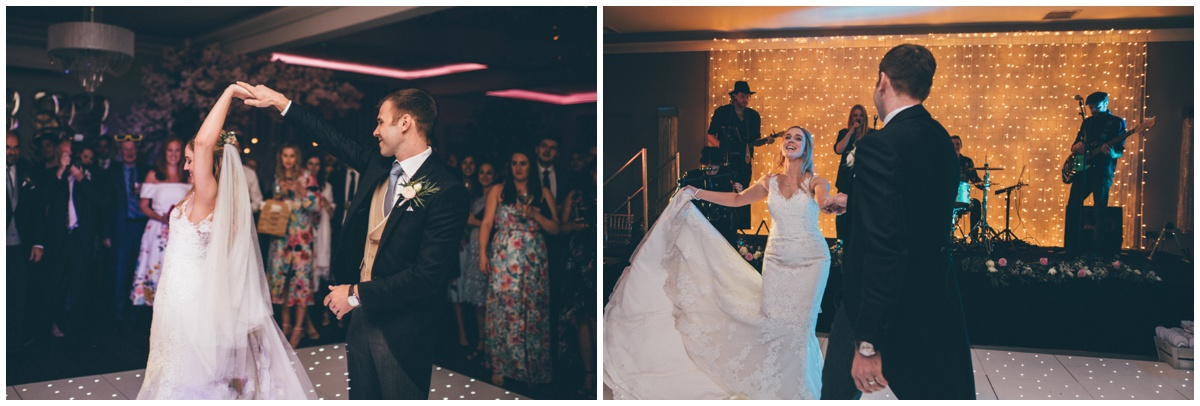 The bride and groom do their First Dance on the lit-up dancefloor at Merrydale Manor.
