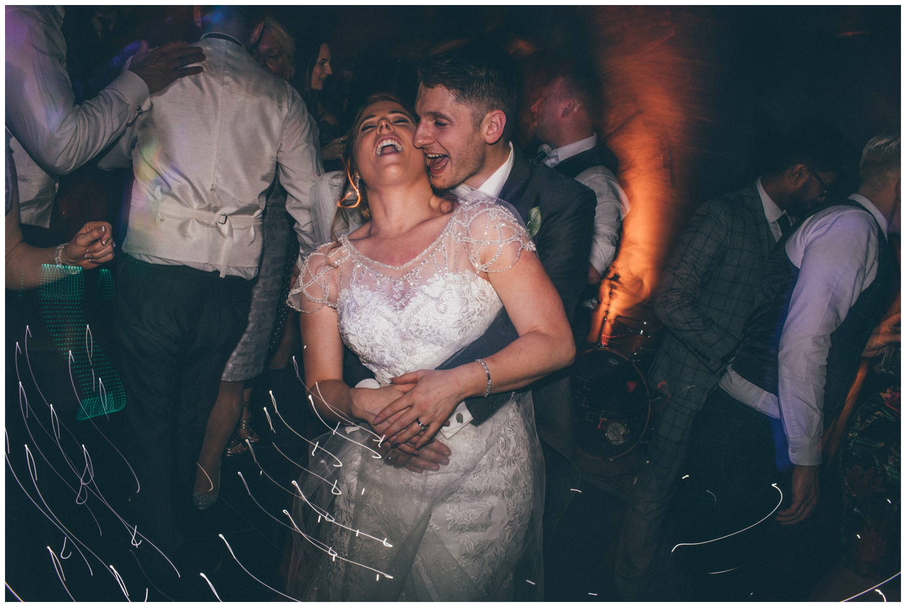 The newlyweds rock the dance floor at Peckforton Castle in Cheshire.