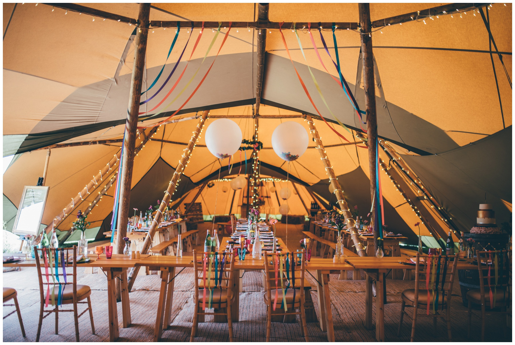Stunning and brightly colourful interior of tipi in Staffordshire wedding.