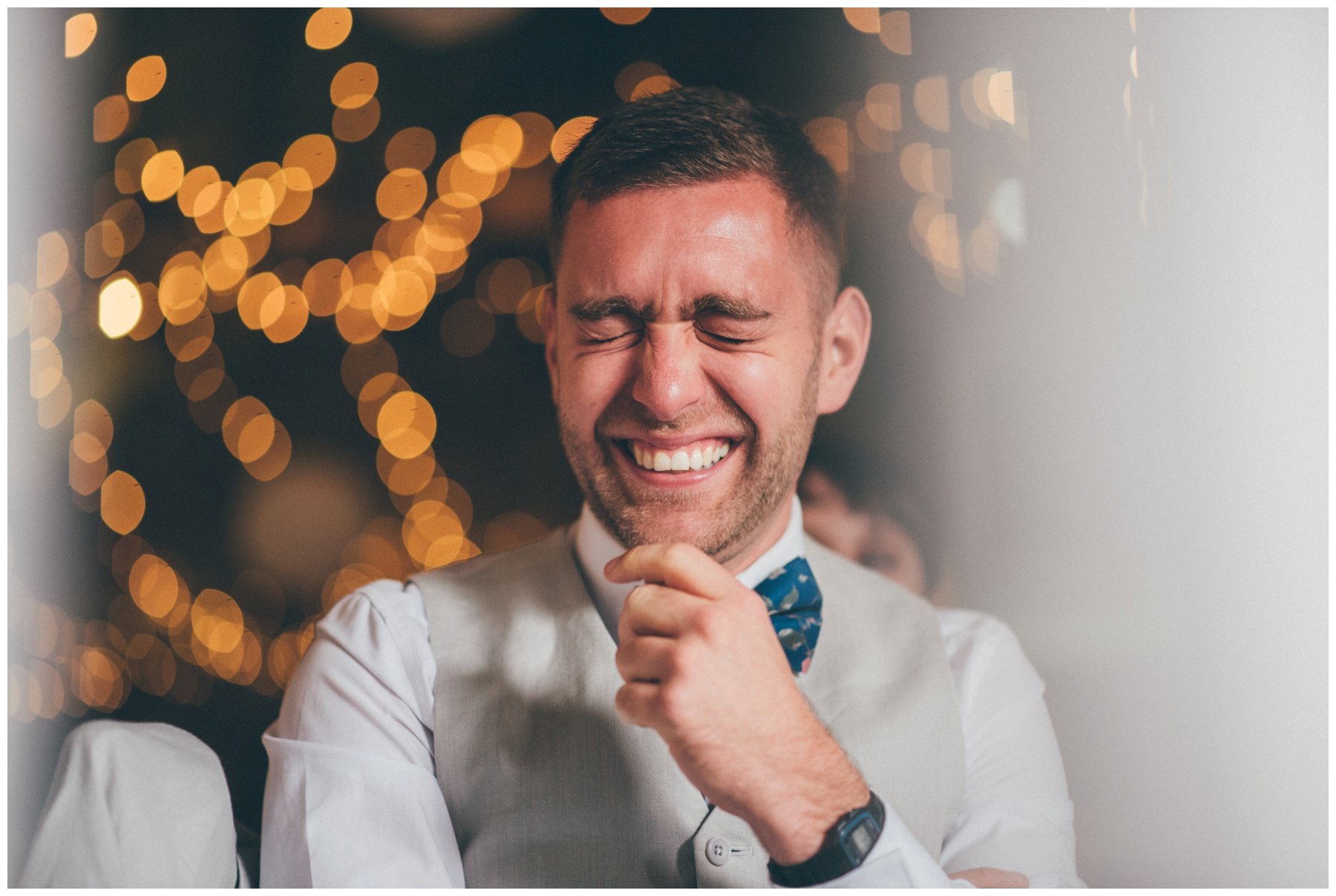 Hysterical wedding guest at Askham Hall, enjoying the wedding speeches.