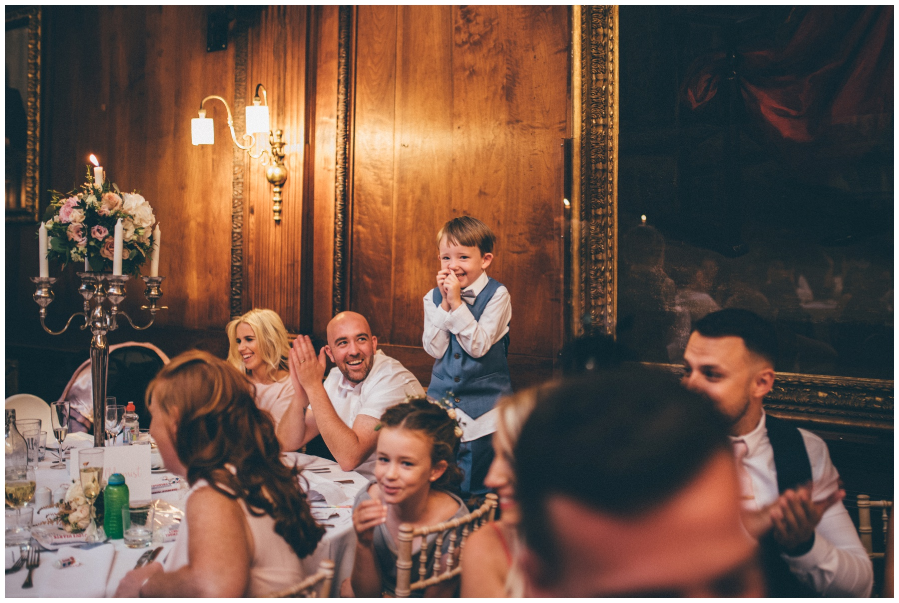 Adorable being little wedding guest gets a round of applause during the speeches at Thornton Manor on the Wirral.