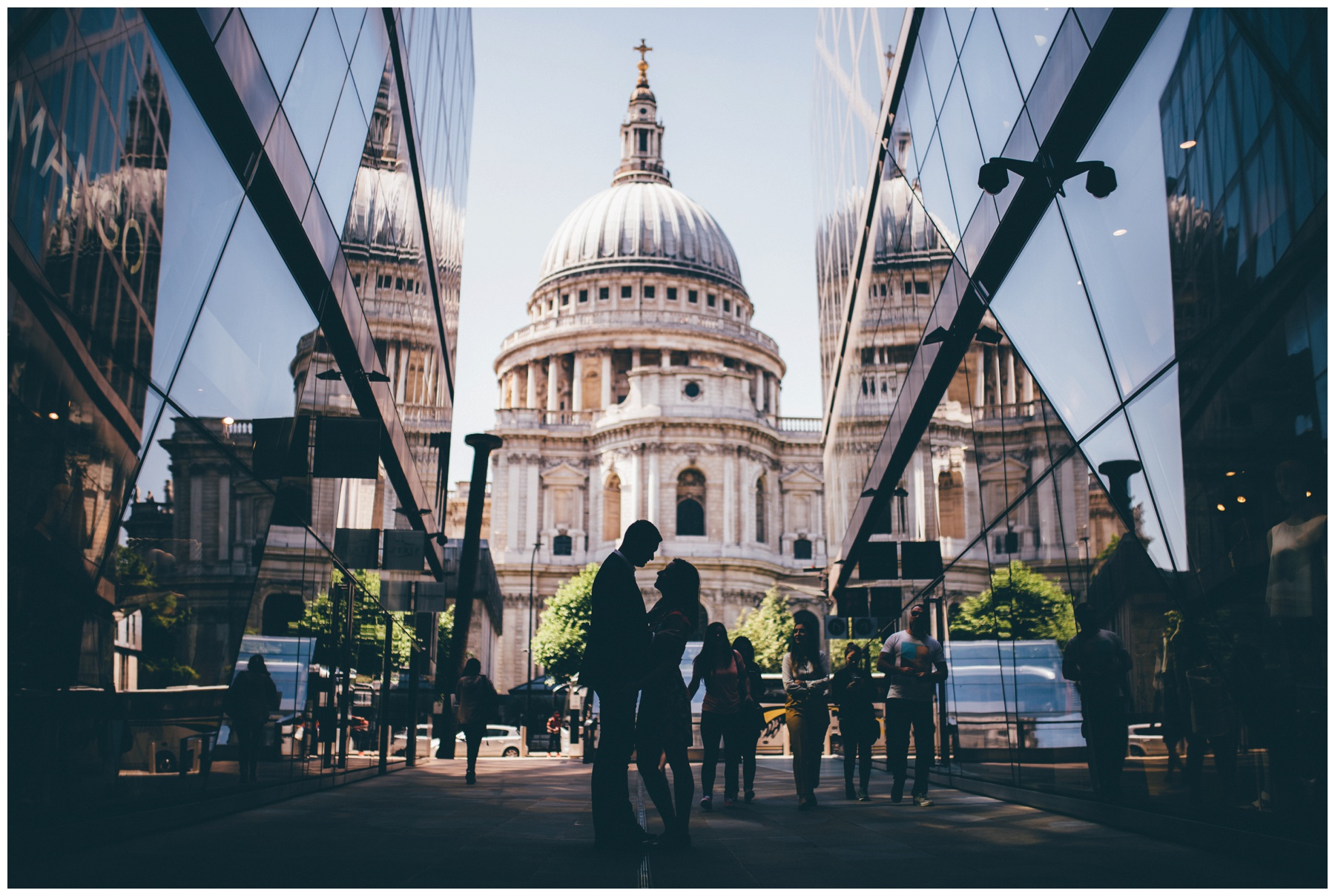 St Paul's Cathedral is the backdrop for a One New Change wedding photoshoot in a London City Centre wedding.