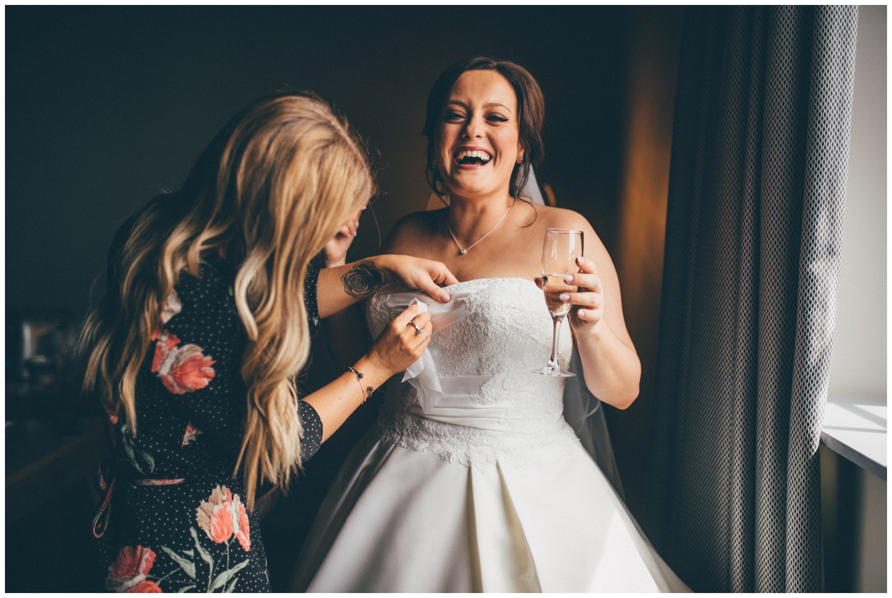 Bride hysterically laughs as the Wirral Make Up Artist wipes her dress clean at the  Titanic Hotel in Liverpool City Centre.
