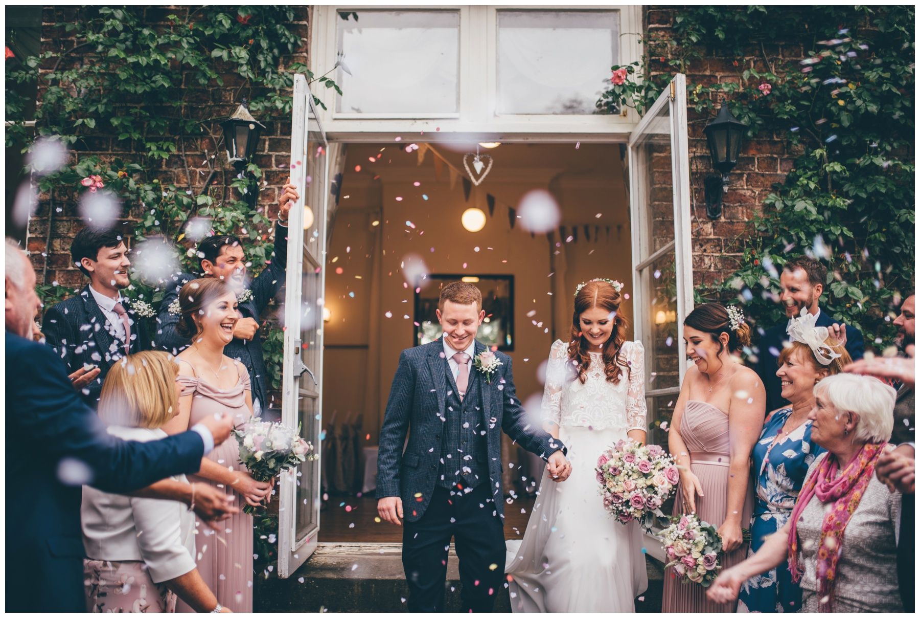 Bride and groom get beautiful confetti thrown at them at Trafford Hall.