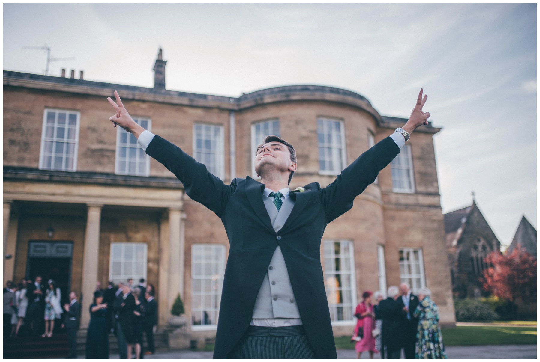 Groomsman celebrates the wedding at Rudding Park hotel.