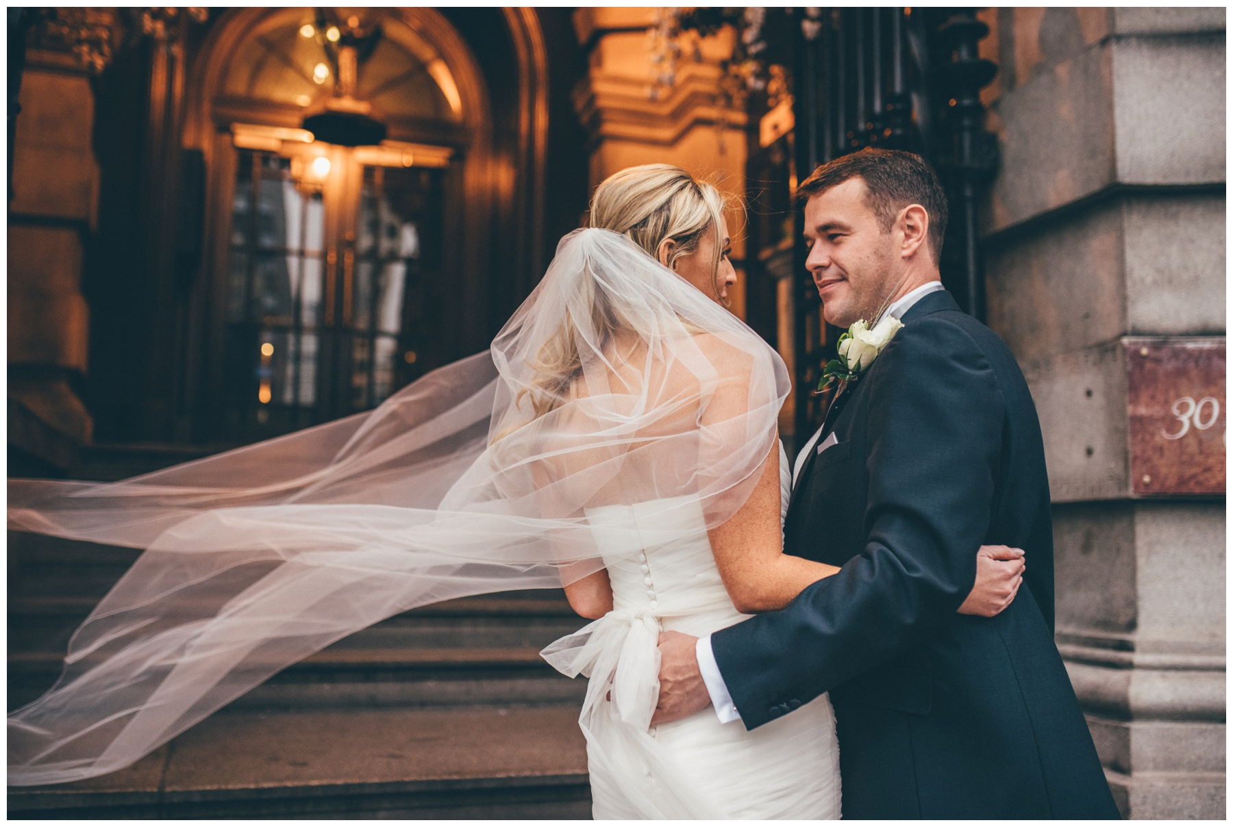 Bride and groom embrace at the front of their Liverpool City Centre wedding, 30 James Street,