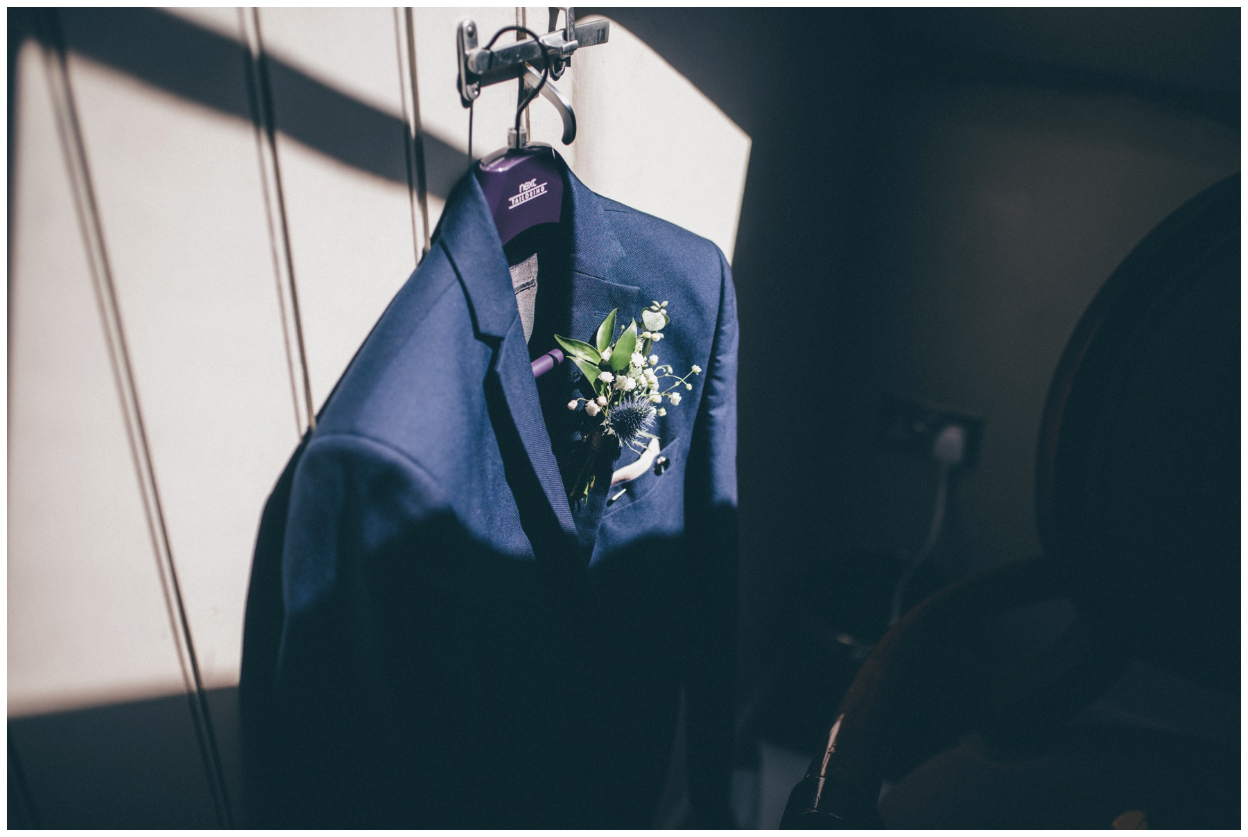 Grooms suit adorned with Thistle buttonhole at Oddfellows in Chester.
