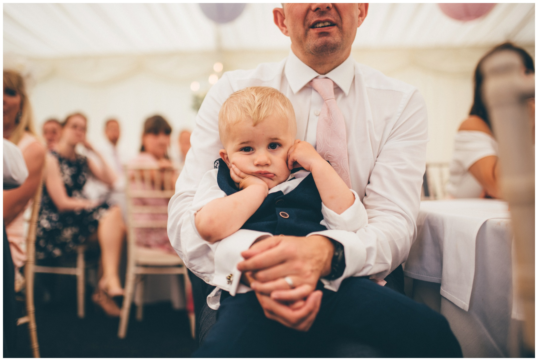 Adorable little wedding venue looks incredibly bored during the wedding speeches at Nunsmere Hall.