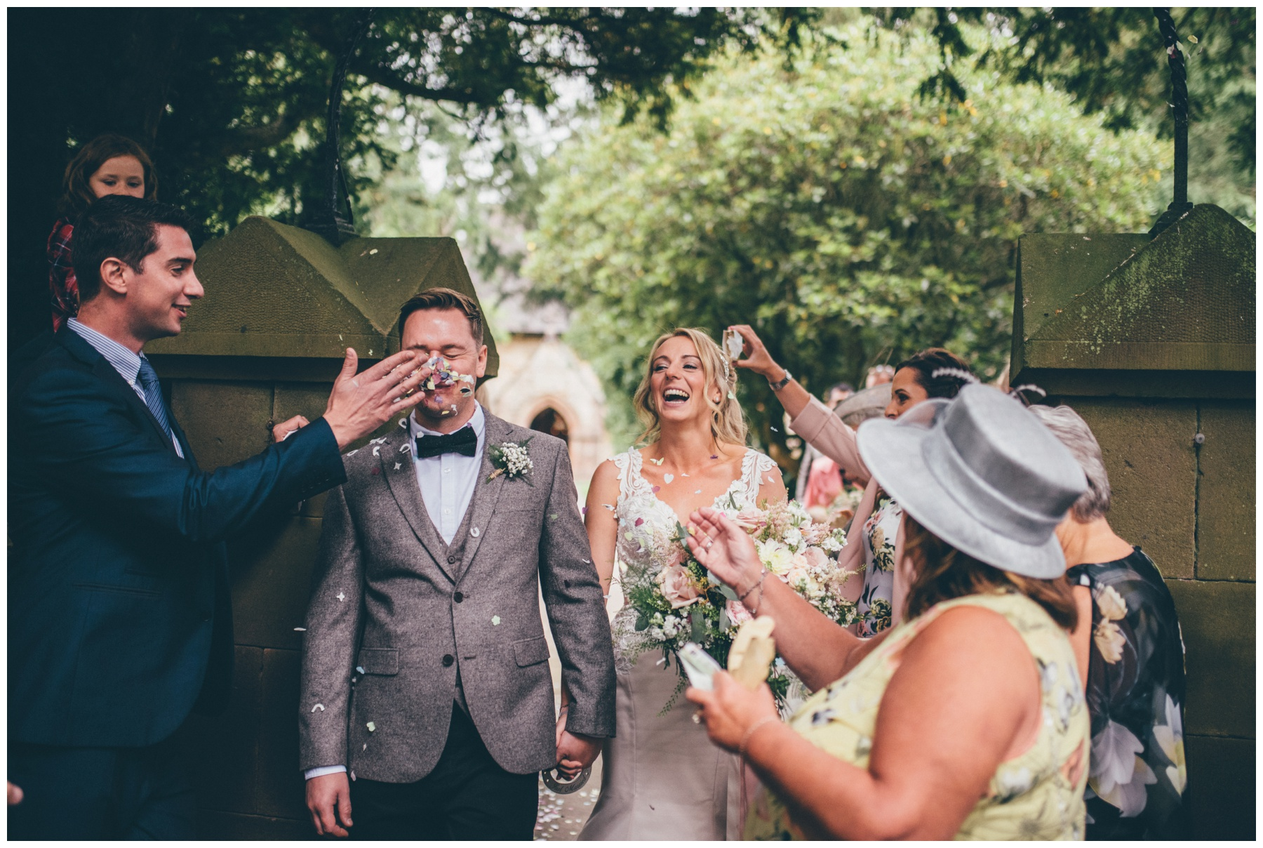 From gets confetti thrown in his face by one of the wedding guests at Staffordshire tipi wedding.