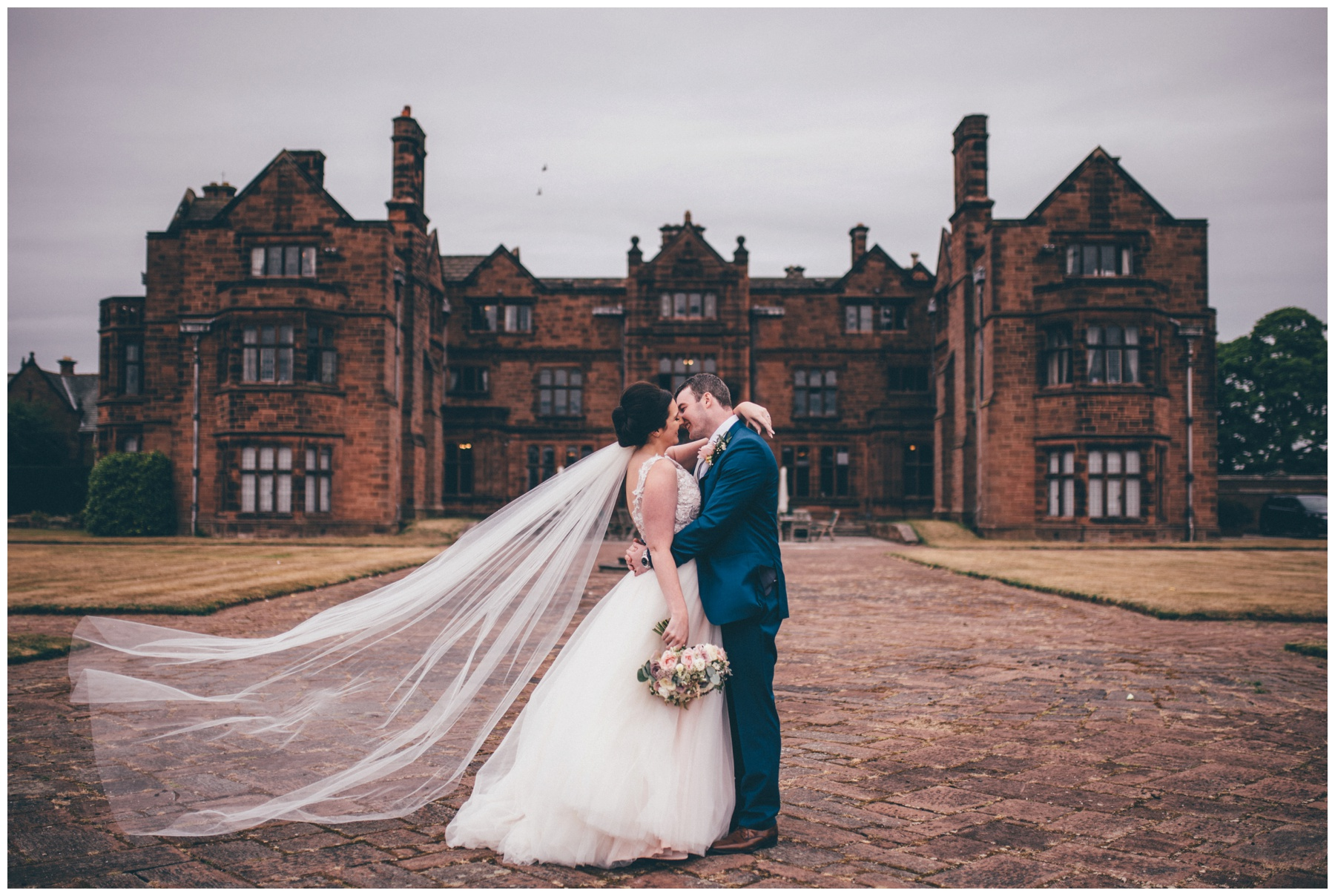 Stunning veil blowing in the wind at summer wedding at Thornton Manor in Cheshire.