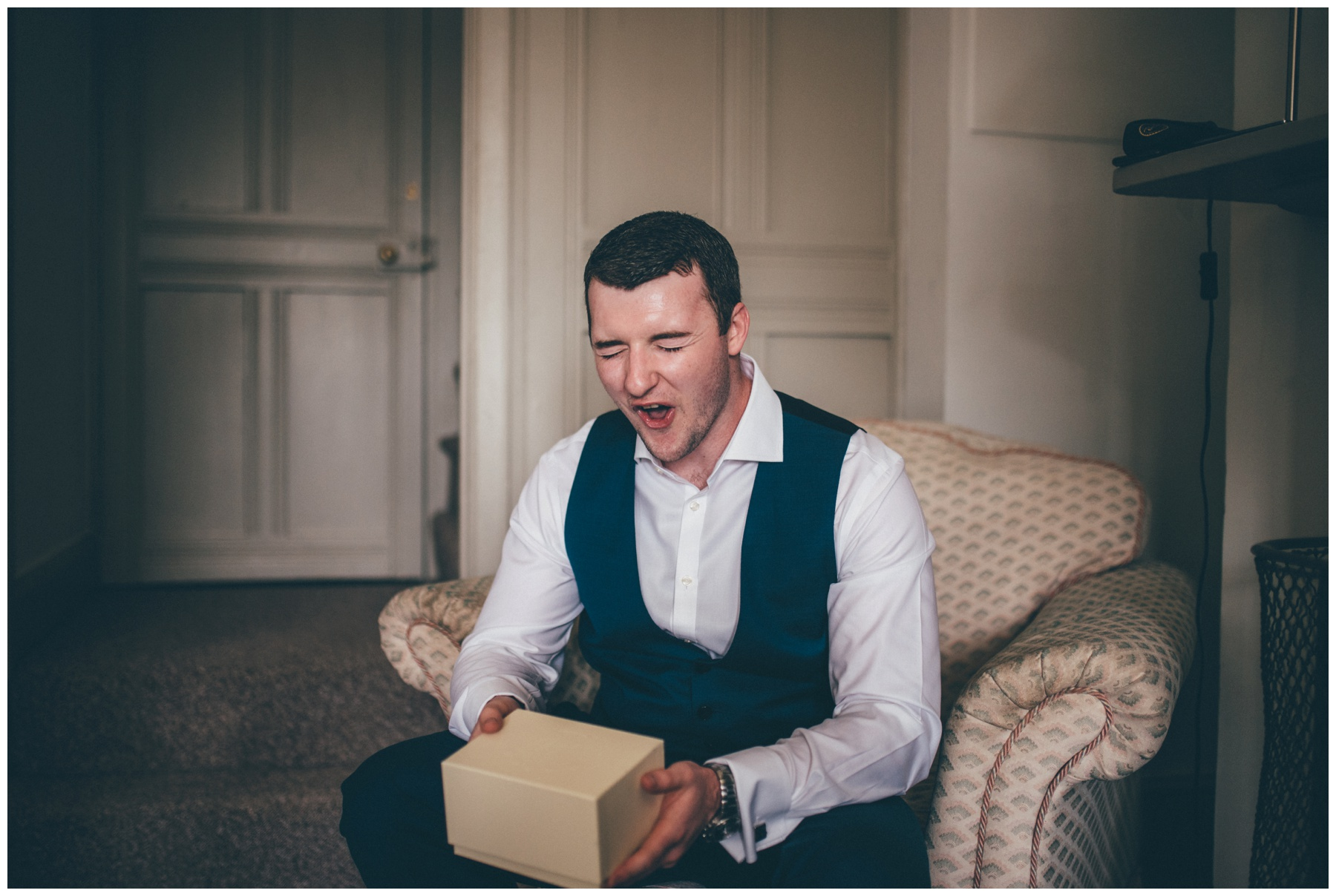 Groom sees his wedding gift from his bride-to-be, a Rolex watch, at Thornton Manor.