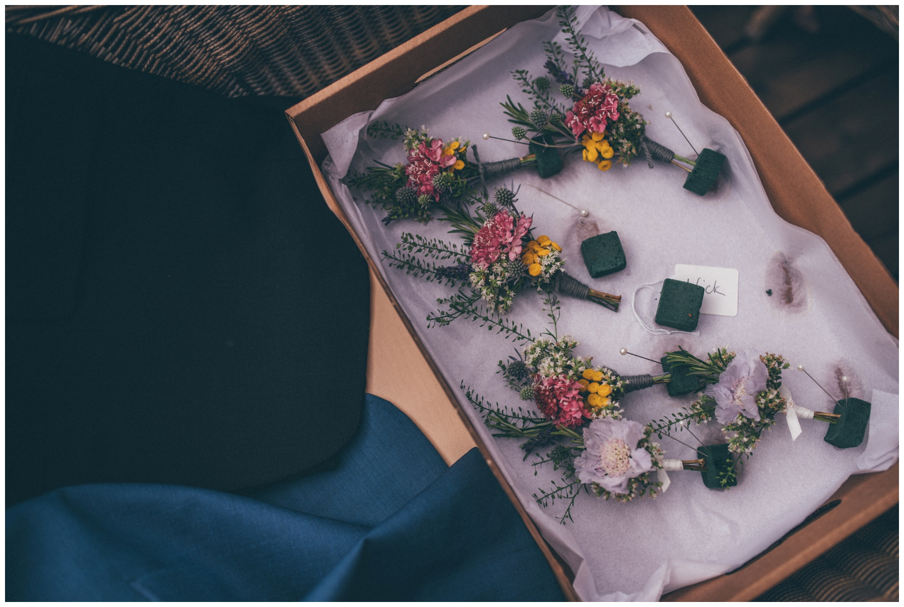 Beautiful bright and wild buttonholes from the groom and groomsmen at Combermere Abbey.