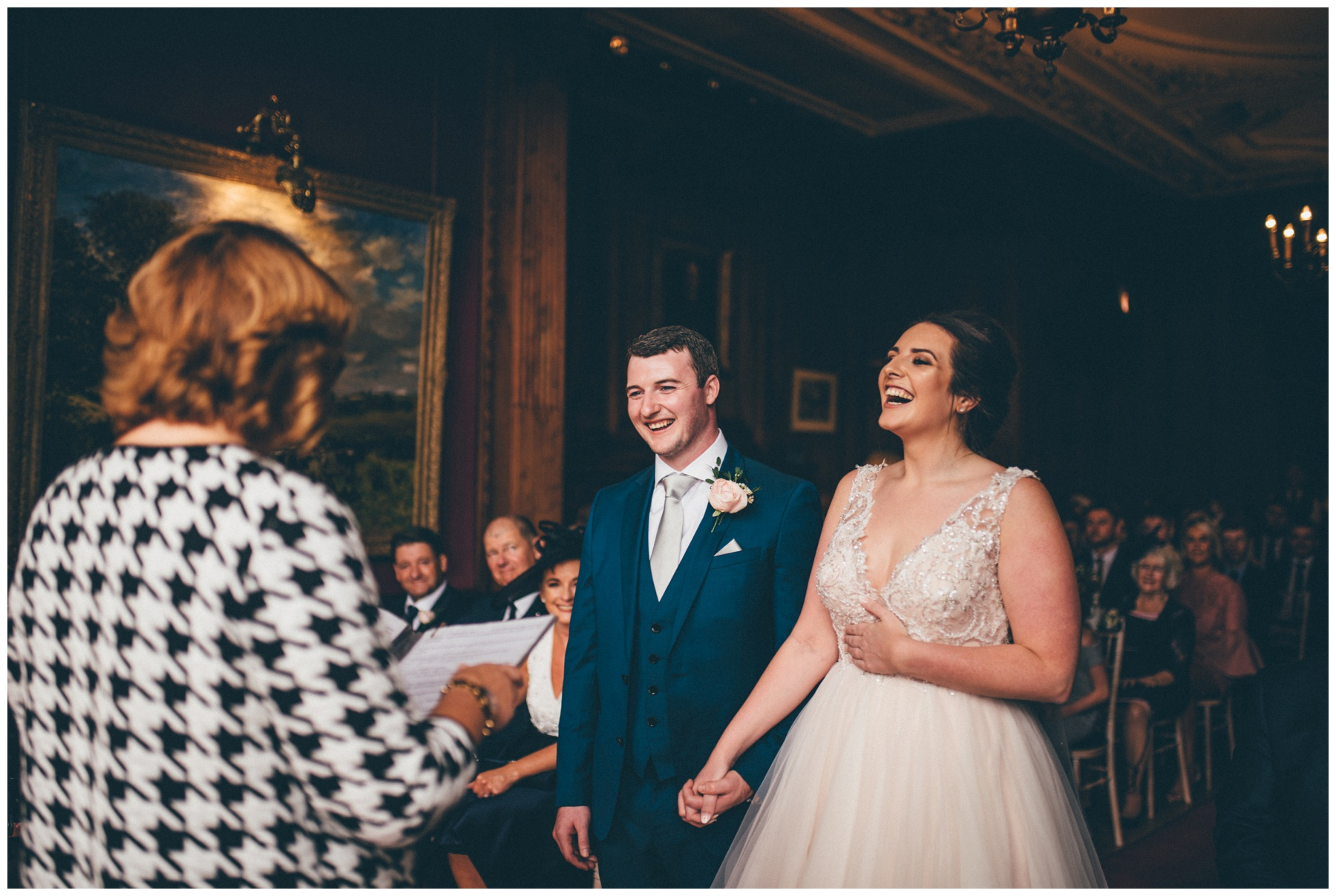 Bride and groom laugh during their wedding ceremony at Thornton Manor.