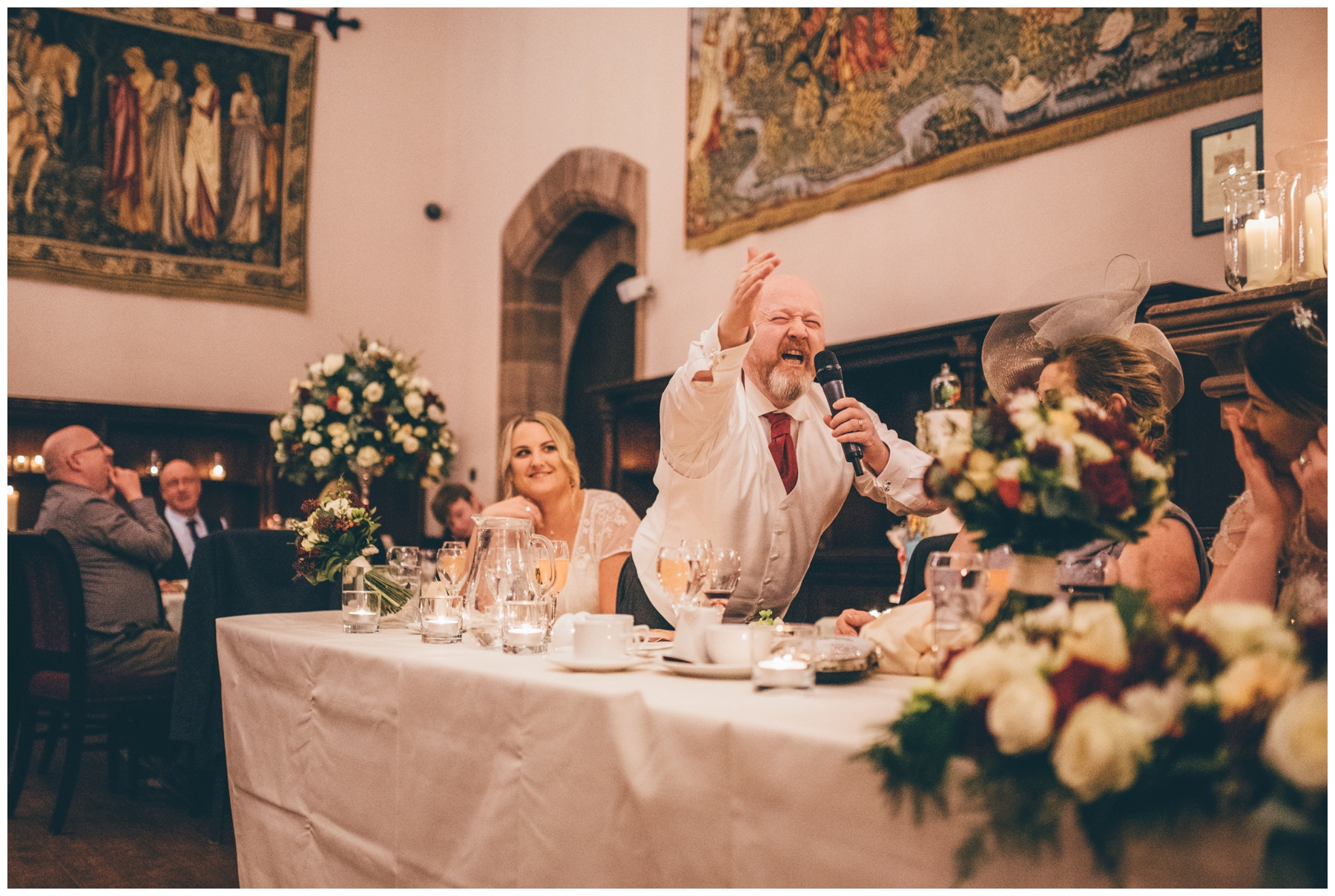 The bride's Dad makes a joke about the bride during his speech at Peckforton Castle in Cheshire.