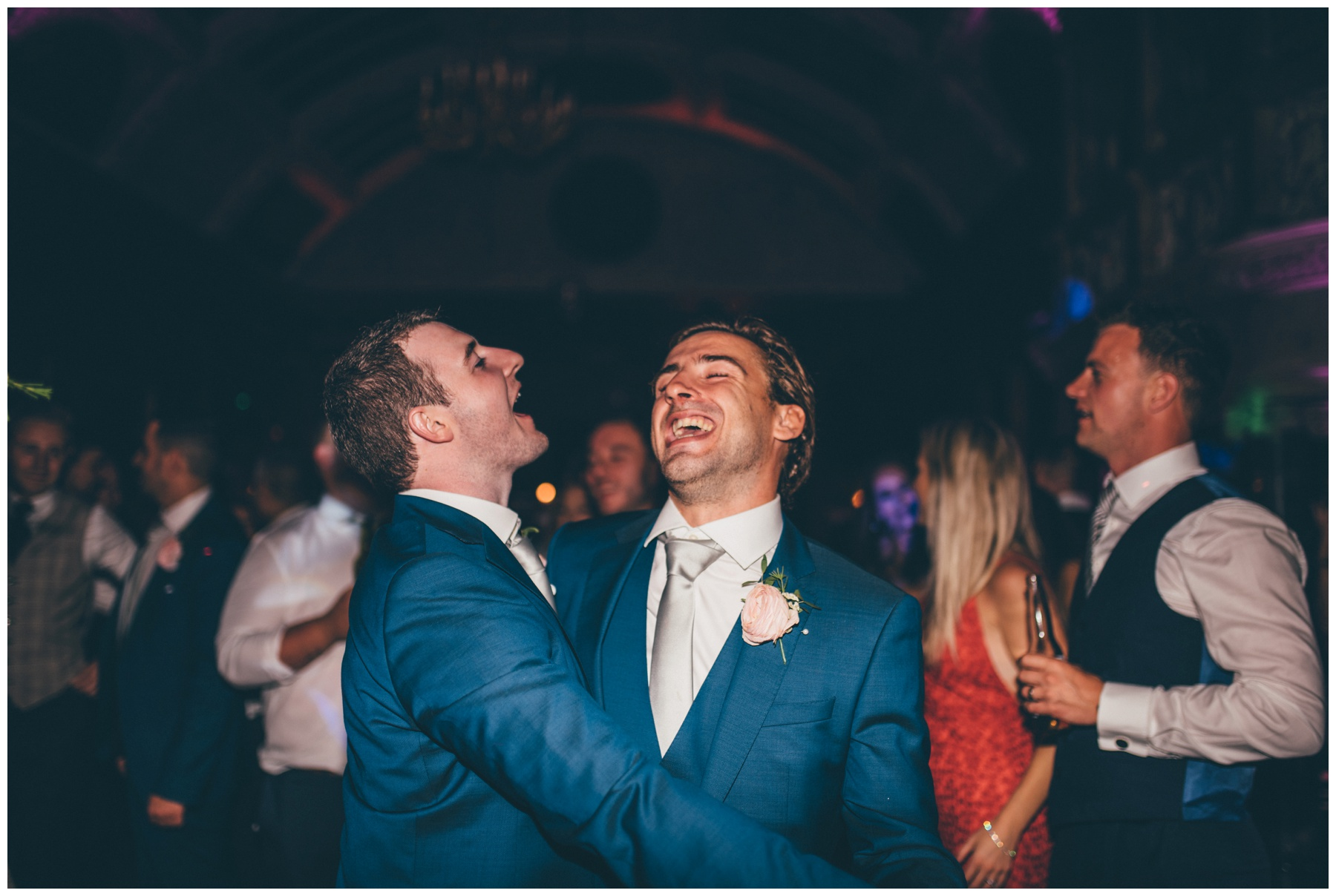 The groom and his Best Man dance and sing and have fun together at Thornton Manor wedding in Cheshire.